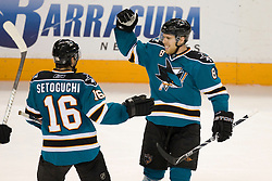 April 22, 2010; San Jose, CA, USA; San Jose Sharks center Joe Pavelski (8) is congratulated by right wing Devin Setoguchi (16) after scoring a goal against the Colorado Avalanche during the second period of game five in the first round of the 2010 Stanley Cup Playoffs at HP Pavilion.  San Jose defeated Colorado 5-0. Mandatory Credit: Jason O. Watson / US PRESSWIRE