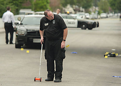 August 21, 2017 - Orange, CA, USA - An evidence technician takes measurements as police investigate a shooting that turned deadly in Orange, CA early Monday morning, August 21, 2017. (Credit Image: © Ken Steinhardt/The Orange County Register via ZUMA Wire)