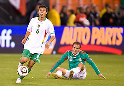 February 24, 2010; San Francisco, CA, USA;  Bolivia midfielder Rolando Ribera (6) steals the ball from Mexico forward Cuauhtemoc Blanco (10) during the first half at Candlestick Park. Mexico defeated Bolivia 5-0.