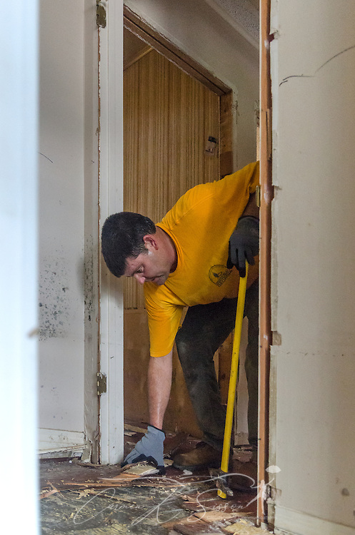 Southern Baptist Disaster Relief volunteer Kenny Rowland, pastor of East Dublin Dayspring Worship Center in East Dublin, Ga., tears out flood-damaged hardwood floors, Aug. 26, 2016, in Denham Springs, La. Rowland, along with other SBDR Georgia volunteers, is helping people mud out their homes following a mid-August flood. (Photo by Carmen K. Sisson)
