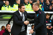 Derby County Manager Frank Lampard and Aston Villa Manager Dean Smith shake hands, with John Terry in the background during the EFL Sky Bet Championship match between Derby County and Aston Villa at the Pride Park, Derby, England on 10 November 2018.