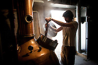 1-7-13---- Alex Thomas stirs a wash of fermented blue corn whisky inside Balcones Distillery in Waco, Texas.