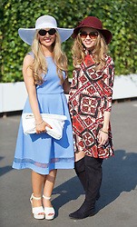 LIVERPOOL, ENGLAND - Thursday, April 9, 2015: Abbie Coakley, 22, from Liverpool wearing a dress from Dorothy Perkins and hat from Primark and Lucy Blakeman, 22, from Liverpool wearing a dress from Asos and hat from Next during Grand Opening Day on Day One of the Aintree Grand National Festival at Aintree Racecourse. (Pic by David Rawcliffe/Propaganda)