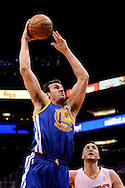 Dec 15, 2013; Phoenix, AZ, USA; Golden State Warriors center Andrew Bogut (12) goes up with the ball against the Phoenix Suns forward Miles Plumlee (22) in the first half at US Airways Center. Mandatory Credit: Jennifer Stewart-USA TODAY Sports