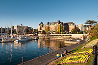 Flowers bloom in planters along the Inner Harbour of Victoria, BC, on a summer evening
