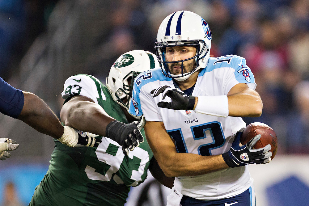 NASHVILLE, TN - DECEMBER 14:   Charlie Whitehurst #12 of the Tennessee Titans tries to avoid the rush of Kenrick Ellis #93 of the New York Jets in the fourth quarter at LP Field on December 14, 2014 in Nashville, Tennessee.  The Jets defeated the Titans 16-11.  (Photo by Wesley Hitt/Getty Images) *** Local Caption *** Charlie Whitehurst; Kenrick Ellis