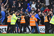 Police and stewards have to hold back Newcastle fans who invaded the pitch after the injury time equaliser scored by Matt Ritchie (11) of Newcastle United during the Premier League match between Bournemouth and Newcastle United at the Vitality Stadium, Bournemouth, England on 16 March 2019.