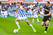 Florent Hadergjonaj of Huddersfield Town (33)  and Matthew Clarke of Derby County (16) in action during the EFL Sky Bet Championship match between Huddersfield Town and Derby County at the John Smiths Stadium, Huddersfield, England on 5 August 2019.