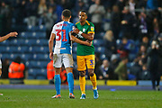 Elliott Bennett of Blackburn Rovers  and Scott Sinclair of Preston North End embrace at full time during the EFL Sky Bet Championship match between Blackburn Rovers and Preston North End at Ewood Park, Blackburn, England on 11 January 2020.