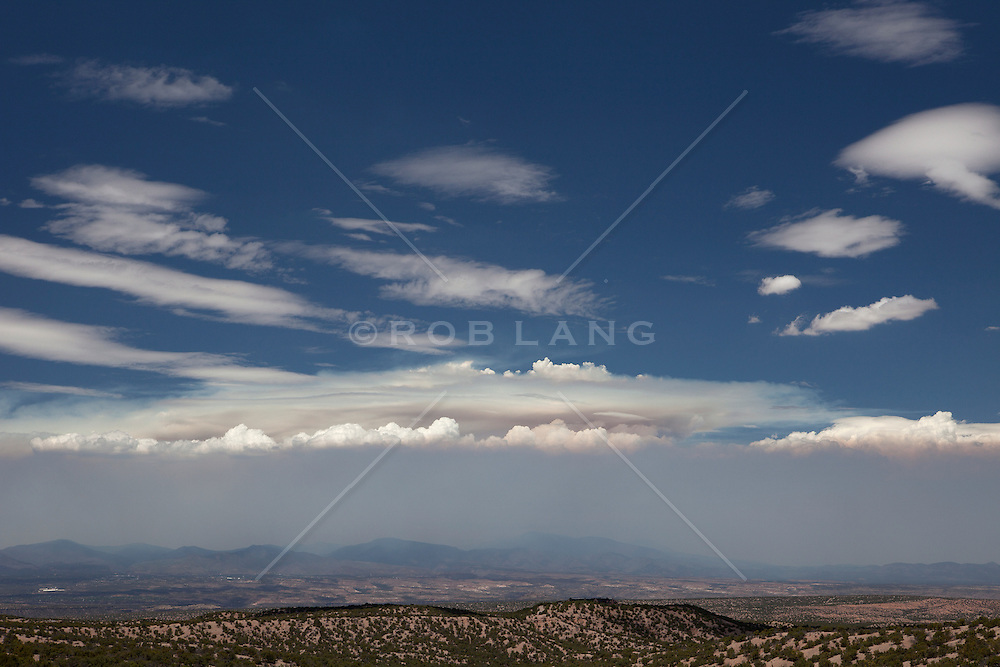 the spectacular mountains and clouds of Santa Fe, New Mexico