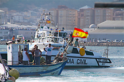 © London News Pictures. 18/08/2013. Gibraltar. Spanish fishermen stage a demonstration by sailing into disputed water between SPain and Gibraltar to protest about a reef put there by the British territory's government. The row over the artificial reef has led to tensions between the UK, Gibraltar and Spain. Photo credit: Donovan Torres/LNP