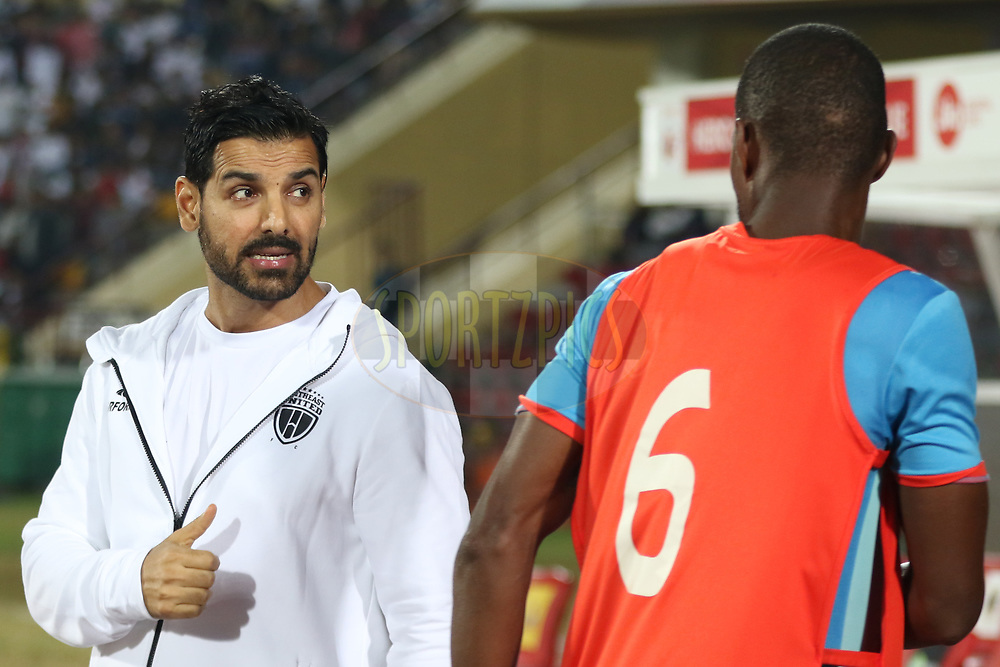 NUFC coowner John cheering up his players during match 19 of the Hero Indian Super League between NorthEast United FC and Bengaluru FC held at the Indira Gandhi Athletic Stadium, Guwahati India on the 8th December 2017<br /> <br /> Photo by: Saikat Das  / ISL / SPORTZPICS