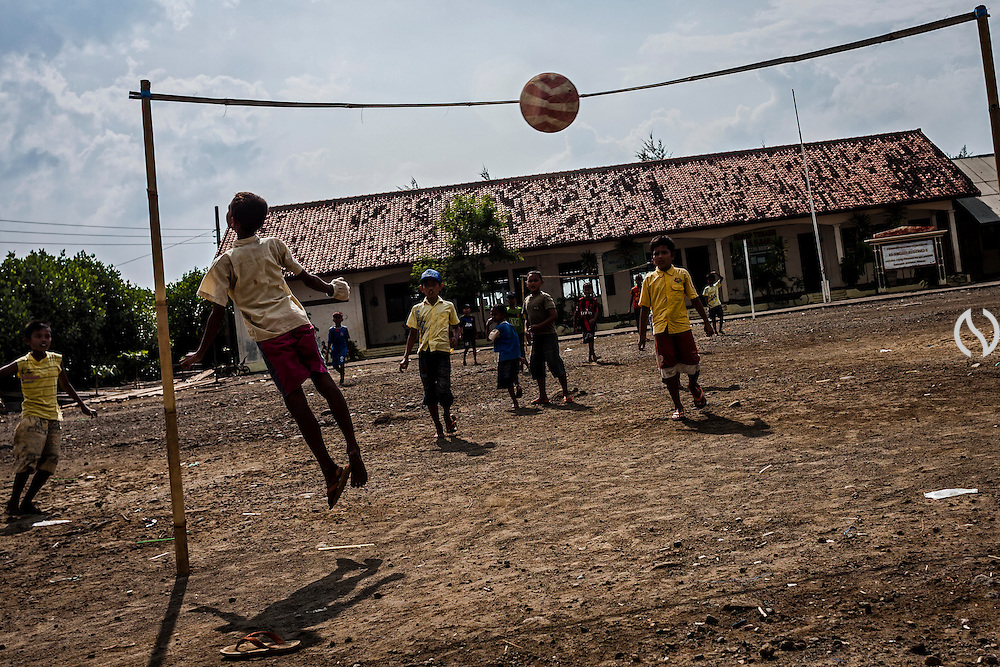 Children play football on the school yard.