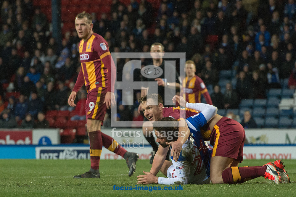 Bradley Dack of Blackburn Rovers and Stephen Warnock of Bradford City get tangled up during the Sky Bet League 1 match at Ewood Park, Blackburn<br /> Picture by Matt Wilkinson/Focus Images Ltd 07814 960751<br /> 29/03/2018
