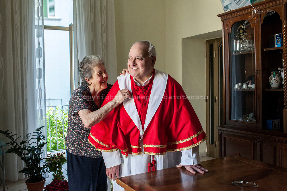 "22 May 2017, San Giorgio a Cremano, Naples Italy - Giorgio Borrelli with his wife Renata into their home in San Giorgio a Cremano. Giorgio is the leader of the ""Portancuolli"". the ""Portancuolli"" are religius devots of San Giorgio Martire saint patron of San Giorgio a Cremano. The ""Portancuolli"" puts on the shoulders the statue of San Giorgio Martire and Madonna during the procession of ""Festa della Lava"" every year the third sunday of month."