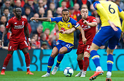 LIVERPOOL, ENGLAND - Saturday, September 22, 2018: Southampton's Ryan Bertrand (left) challenges Liverpool's Xherdan Shaqiri during the FA Premier League match between Liverpool FC and Southampton FC at Anfield. (Pic by Jon Super/Propaganda)