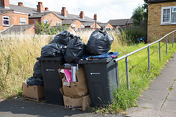 &copy; Licensed to London News Pictures. 25/07/2017. Birmingham, UK. The strike by Birmingham bin men continues as piles of rubbish in certain areas goes uncollected.<br /> Pictured rubbish outside one family home in Kimberley Avenue, Alum Rock.  Photo credit: Dave Warren/LNP