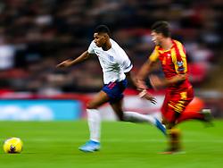 Marcus Rashford of England is challenged by Nikola Vukcevic of Montenegro - Rogan/JMP - 14/11/2019 - FOOTBALL - Wembley Stadium - London, England - England v Montenegro - UEFA Euro 2020 Qualifiers.