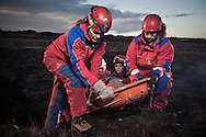 ICE-SAR volunteer rescuers carry a casualty in stretchers.