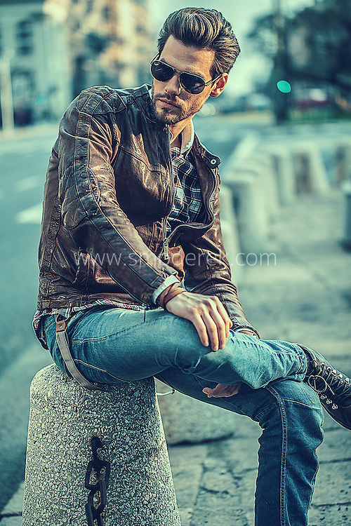 Headshot of a male model Tomek in a leather jacket editorial style.