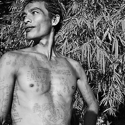 Magical tattoos meant to provide protection cover a man in Battambang, Cambodia.