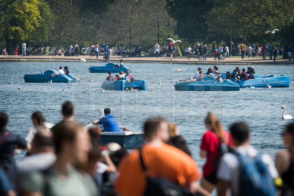 © Licensed to London News Pictures. 22/04/2019. London, UK. Members of the public relax in the heat on Serpentine Lake in Hyde Park, central London on what has been a record breaking Easter bank holiday weekend for temperatures. Photo credit: Ben Cawthra/LNP