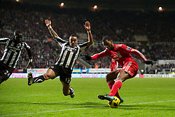 NEWCASTLE, ENGLAND - Saturday, December 11, 2010: Liverpool's Ryan Babel and Newcastle United's Danny Simpson during the Premiership match at St James' Park. (Photo by: David Rawcliffe/Propaganda)