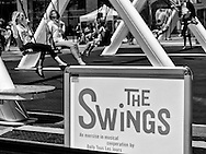"""""""The Swings: An Exercise in Musical Cooperation"""" is a giant, collective musical instrument that brings together people of all ages and backgrounds. Each swing represents on of four instruments - piano, harp, guitar, vibraphone - and triggers sound when participants swing back and forth.  Battery Park City, New York."""