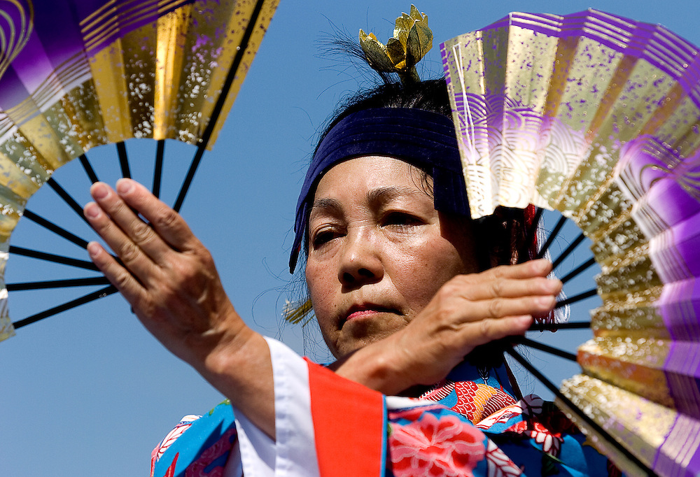 080208      Brian Leddy.Yaeko Miyazato performs a traditional Okinowa dance during a performance on Saturday at the Gallup Flea Market. Miyazato was on of several that travelled from Albuquerque to perform.