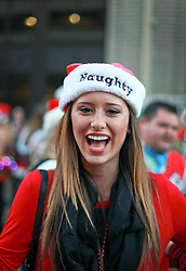 13 December 2014. New Orleans, Louisiana. <br /> Lauren Clark at the 4th annual running of the Santas in downtown New Orleans. Proceeds from the event benefit 'That Others May Love' charity.<br /> Photo; Charlie Varley/varleypix.com