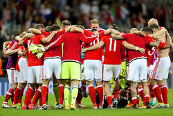 TOULOUSE, FRANCE - Monday, June 20, 2016: Wales players celebrate with a team-huddle after the 3-0 victory over Russia and reaching the knock-out stage during the final Group B UEFA Euro 2016 Championship match at Stadium de Toulouse. (Pic by David Rawcliffe/Propaganda)