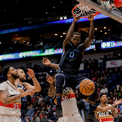 Jan 7, 2019; New Orleans, LA, USA; Memphis Grizzlies forward JaMychal Green (0) dunks over New Orleans Pelicans forward Anthony Davis (23) and forward Julius Randle (30) during the second quarter at the Smoothie King Center. Mandatory Credit: Derick E. Hingle-USA TODAY Sports