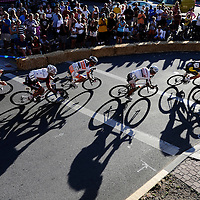 Riders navigate a corner while competing in Stage 4 of the Cascade Cycling Classic held in Downtown Bend on Saturday.