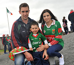 Supporting Mayo Thomas Birrane aged 2 with his parents Thomas and Mimi Bradley from Crossmolina at the Connacht Final in Dr. Hyde Park.<br /> Pic Conor McKeown