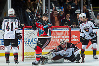 KELOWNA, CANADA - NOVEMBER 10: Carsen Twarynski #18 of the Kelowna Rockets celebrates a first period assist against Todd Scott #1 of the Vancouver Giants on November 10, 2017 at Prospera Place in Kelowna, British Columbia, Canada.  (Photo by Marissa Baecker/Shoot the Breeze)  *** Local Caption ***