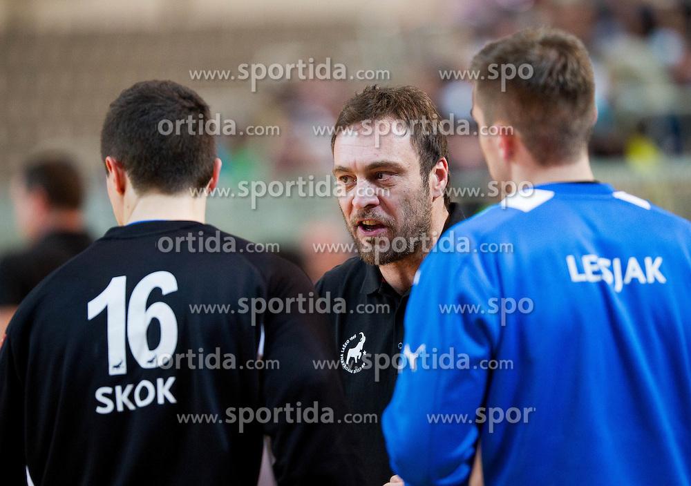 Dejan Peric of Celje talks to Matevz Skok of Celje and Urban Lesjak of Celje during handball match between RK Cimos Koper and RK Celje Pivovarna Lasko in 26th Round of 1st NLB Leasing league 2012/13 on April 14, 2013 in Arena Bonifika, Koper, Slovenia. (Photo By Vid Ponikvar / Sportida)