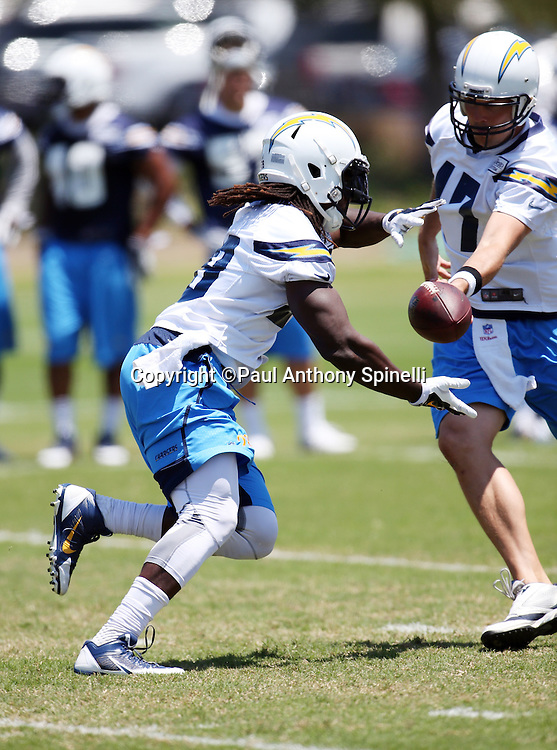 San Diego Chargers rookie running back Melvin Gordon (28) takes a handoff from San Diego Chargers quarterback Philip Rivers (17) during the San Diego Chargers Spring 2015 NFL minicamp practice held on Tuesday, June 16, 2015 in San Diego. (©Paul Anthony Spinelli)