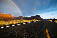 Highway 211, mesas, and a rainbow  in the desert of Southeast Utah, USA.