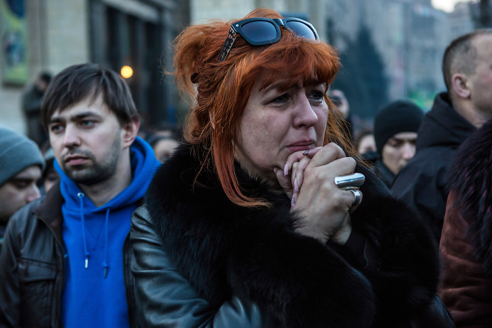 KIEV, UKRAINE - FEBRUARY 21: A woman mourns during a funeral procession for two anti-government protesters killed in fighting with police on February 21, 2014 in Kiev, Ukraine. After a week that saw new levels of violence, with dozens killed, opposition and government representatives reached an agreement intended to resolve the crisis. (Photo by Brendan Hoffman/Getty Images) *** Local Caption ***