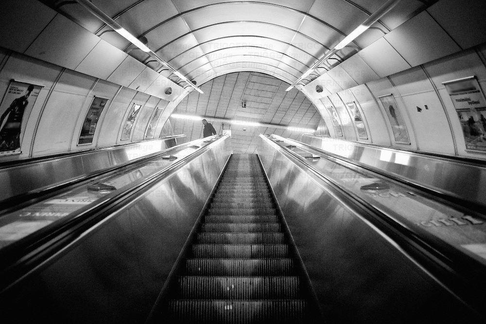 A man at the end of the escalator, in an underground station