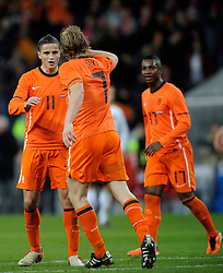 09-02-2011 VOETBAL: NEDERLAND - OOSTENRIJK: EINDHOVEN<br /> Netherlands in a friendly match with Austria won 3-1 / Penalty Dirk Kuyt  NED scored the 3-0 and celebrate with Ibrahim Afellay<br /> ©2011-WWW.FOTOHOOGENDOORN.NL