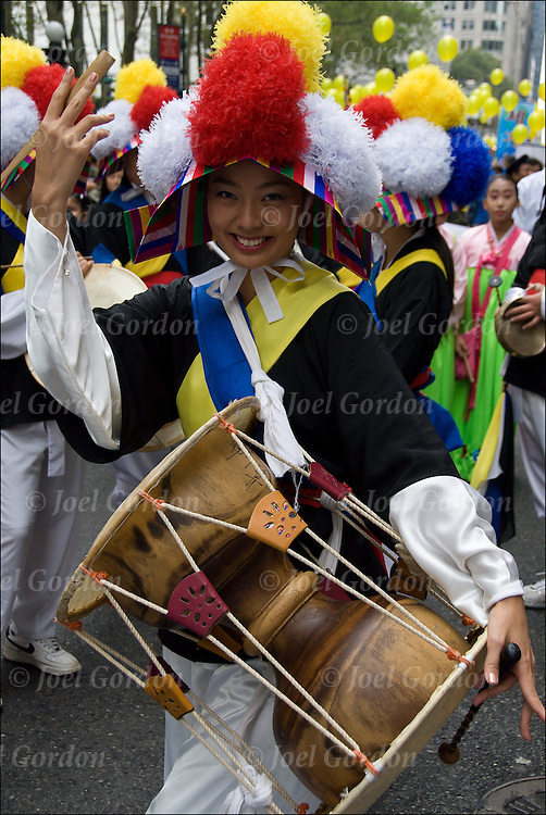 Korean-Americans wearing traditional folk famer's costume to when celebrtating the harvest during the 29th Annual Korean Harvest Parade in New York City.