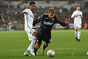 Leeds United forward Patrick Bamford (9) and Swansea City defender Kyle Naughton (26) challenge in the area during the EFL Sky Bet Championship match between Swansea City and Leeds United at the Liberty Stadium, Swansea, Wales on 21 August 2018.