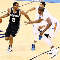 06 May 2016: Oklahoma City Thunder guard Andre Roberson (21) and Oklahoma City Thunder forward Serge Ibaka (9) defend on San Antonio Spurs forward Kawhi Leonard (2) during the San Antonio Spurs 100-96 victory over the Oklahoma City Thunder, during Game Three of the Western Conference Semifinals of the NBA Playoffs at the Chesapeake Energy Arena, Oklahoma City, Oklahoma, USA.