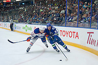PENTICTON, CANADA - SEPTEMBER 16: Matt Benning #83 of Edmonton Oilers checks Michael Carcone #58 of Vancouver Canucks on September 16, 2016 at the South Okanagan Event Centre in Penticton, British Columbia, Canada.  (Photo by Marissa Baecker/Shoot the Breeze)  *** Local Caption *** Matt Benning; Michael Carcone;