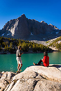 Hikers enjoying the view from Big Pine Lake #3, John Muir Wilderness, Sierra Nevada Mountains, California USA