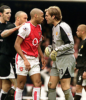 Thierry Henry (Arsenal) Roy Carroll (Utd) Face to Face. Arsenal v Manchester United. @ Highbury. 28/3/04. Credit : Colorsport/Andrew Cowie.