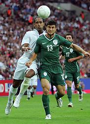 Glen Johnson battles with Bojan Jokic during the international friendly match between England and Slovenia at Wembley Stadium, London on the 5th September 2009