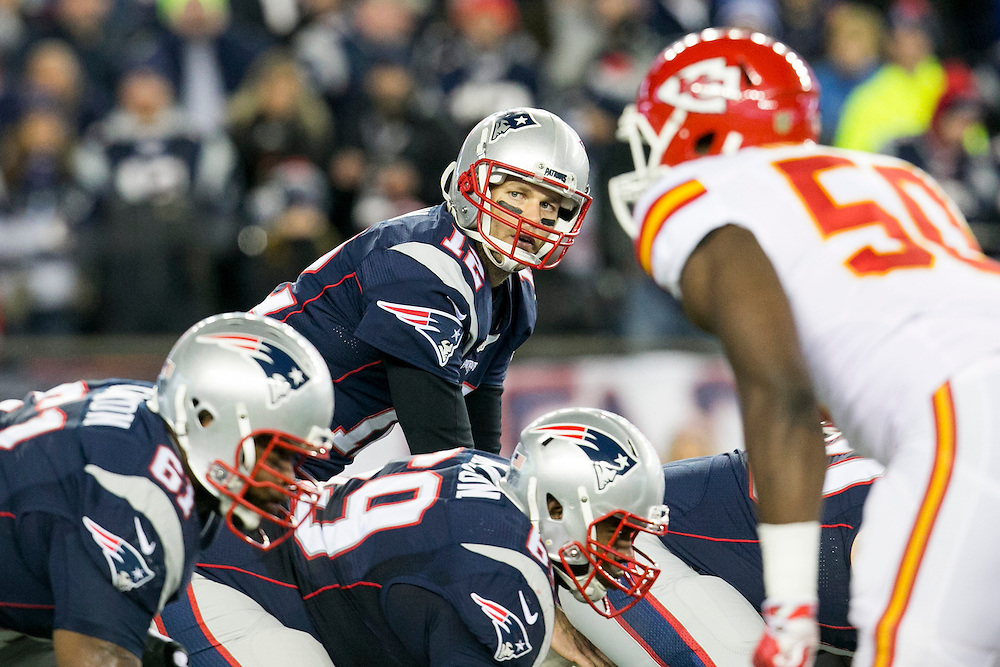 New England Patriots quarterback Tom Brady (12) checks the Kansas City Chiefs defense at the line of scrimmage in the second quarter of the AFC Divisional Playoff game at Gillette Stadium in Foxborough, Massachusetts on January 16, 2016.     Photo by Kelvin Ma/ UPI