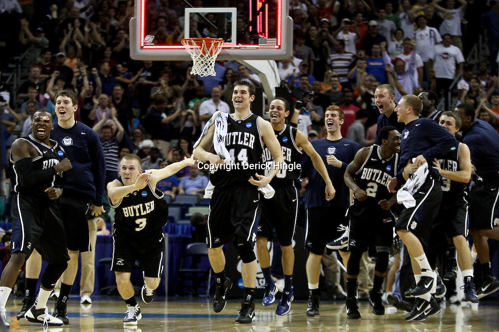 Mar 26, 2011; New Orleans, LA; Butler Bulldogs players rush the court following a win over the Florida Gators in the semifinals of the southeast regional of the 2011 NCAA men's basketball tournament at New Orleans Arena. Butler defeated Florida 74-71.  Mandatory Credit: Derick E. Hingle
